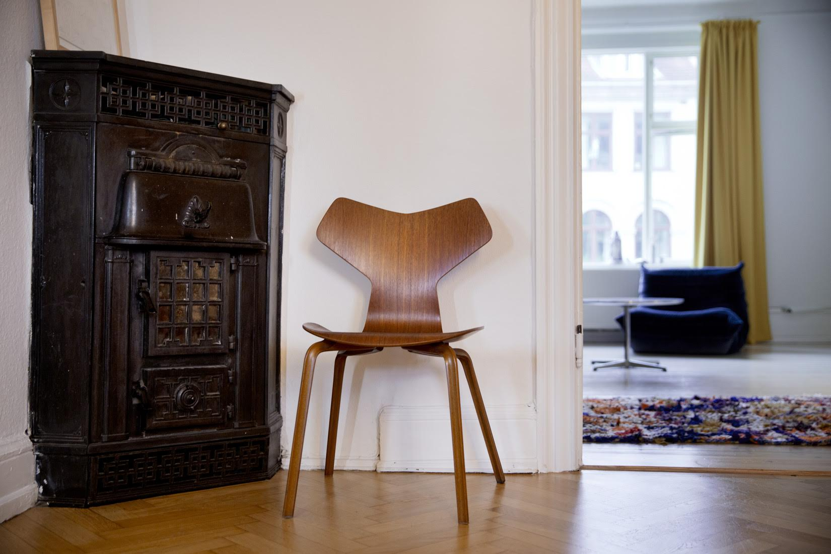 Fireplace and chair. Kasper Bjorke and Fie Paruup, How I live, The Spaces. Photography Anne Mie Dreves