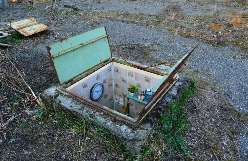Street artist Biancoshock installs tiny rooms in Milan's manholes