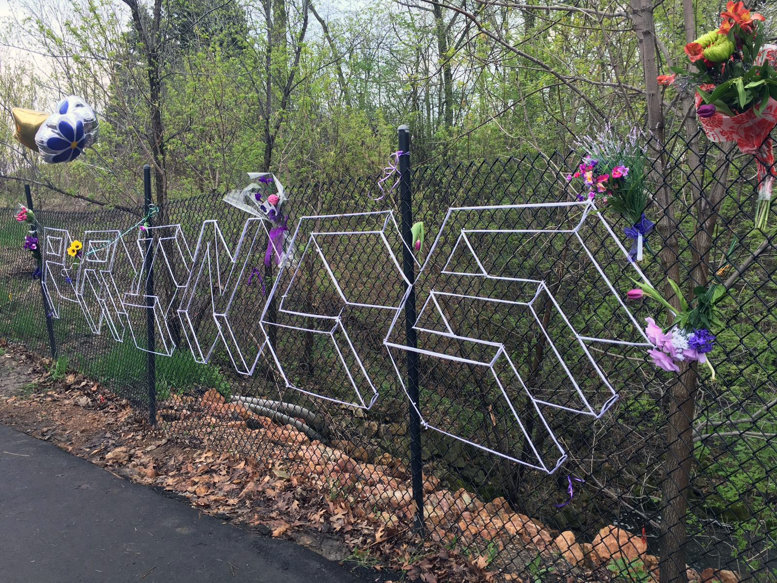 A fan tribute to prince on the chain-link fence outside Paisley Park. Photography: Tara McBride