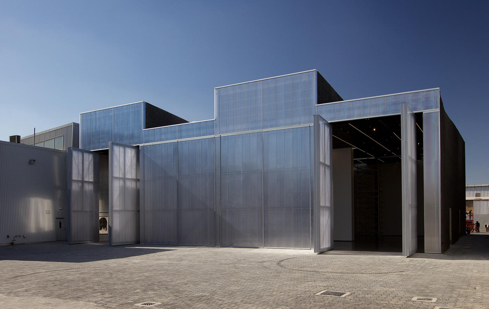 Concrete cultural space by OMA on Dubai's Alserkal Avenue