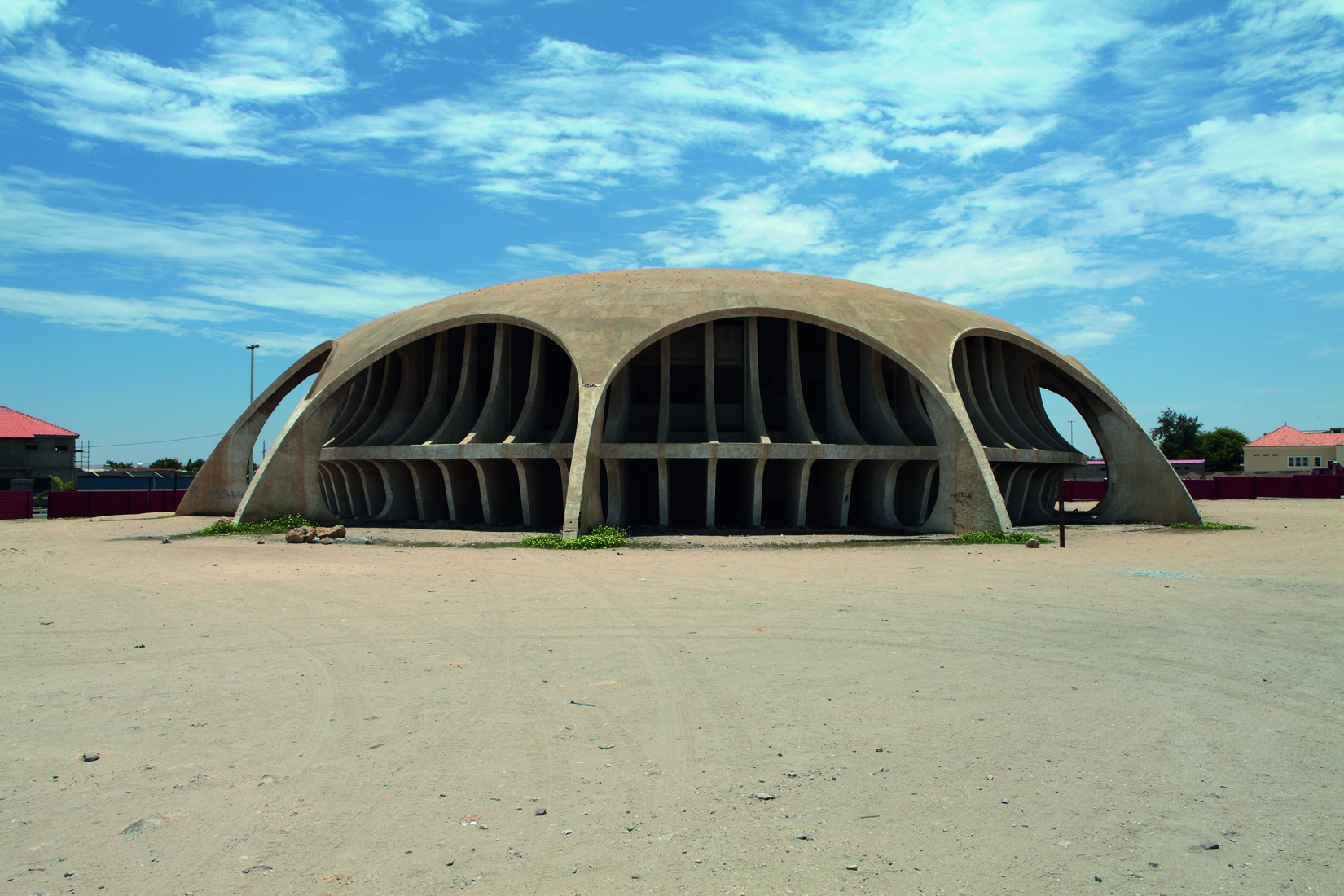 Designed by Botelho Vasconcelos of Atelier Boper, Cine Estudio in Namibe, Provincia Namibe, was never completed. While it currently lies in poor condition, a rehabilitation project is underway. Photography: Walter Fernandes/Goethe-Institut Angola