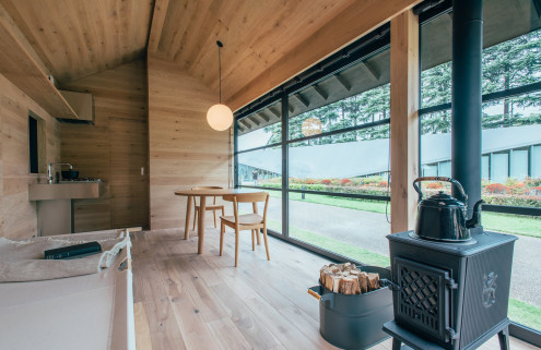Muji unveils prefab huts designed by Morrison, Grcic and Fukasawa