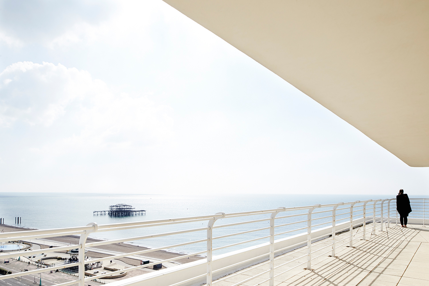 A view of the burnt down Brighton pier from the balcony of Embassy Court. Photography: Baker