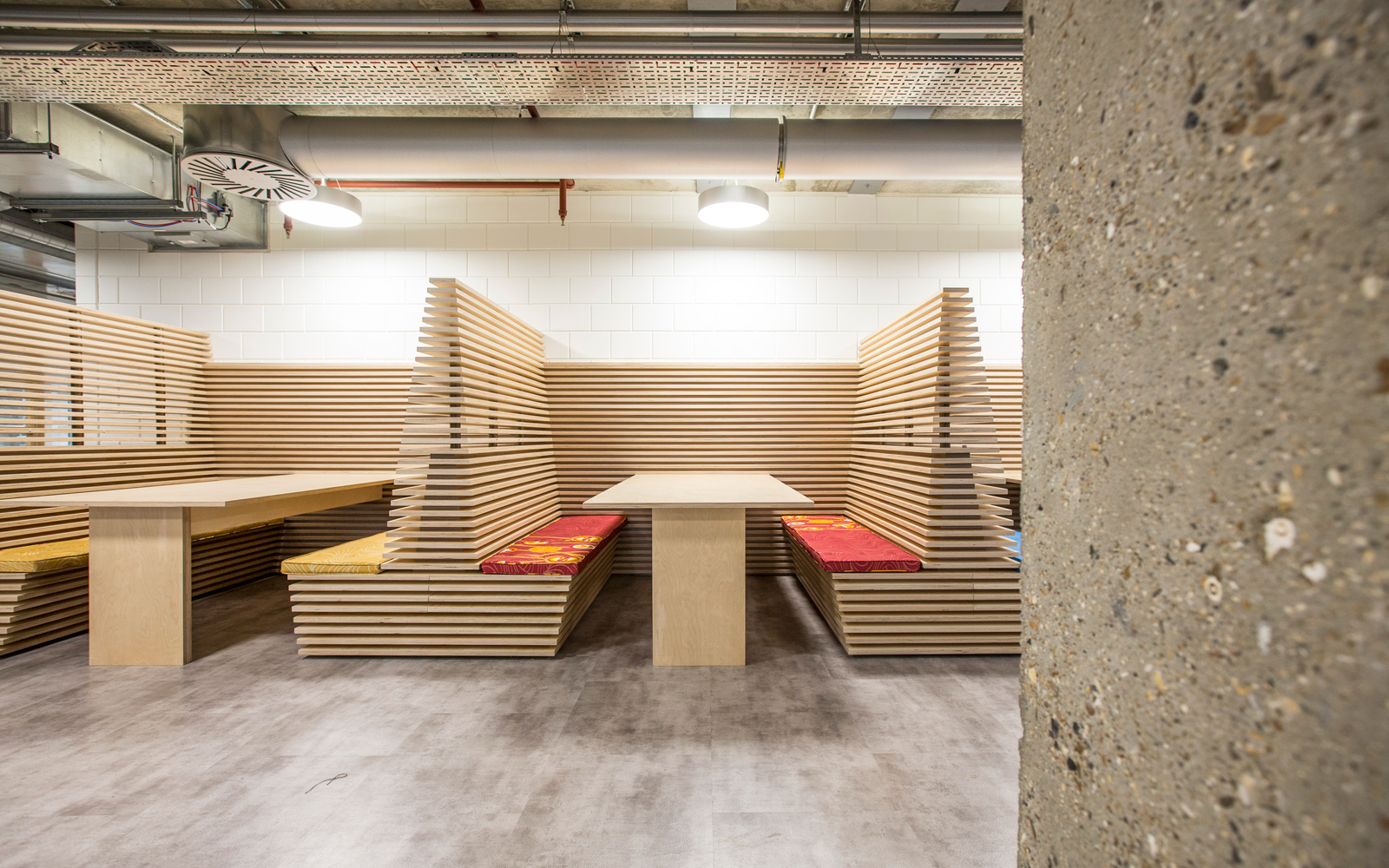 Breakout booths made from slatted plywood