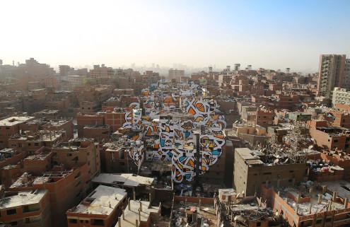 Street artist eL Seed paints a mural across 50 Cairo buildings