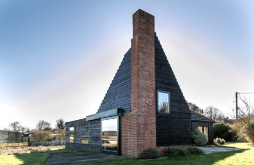 An angular brick and timber house on the Norfolk coast is available for £695,000