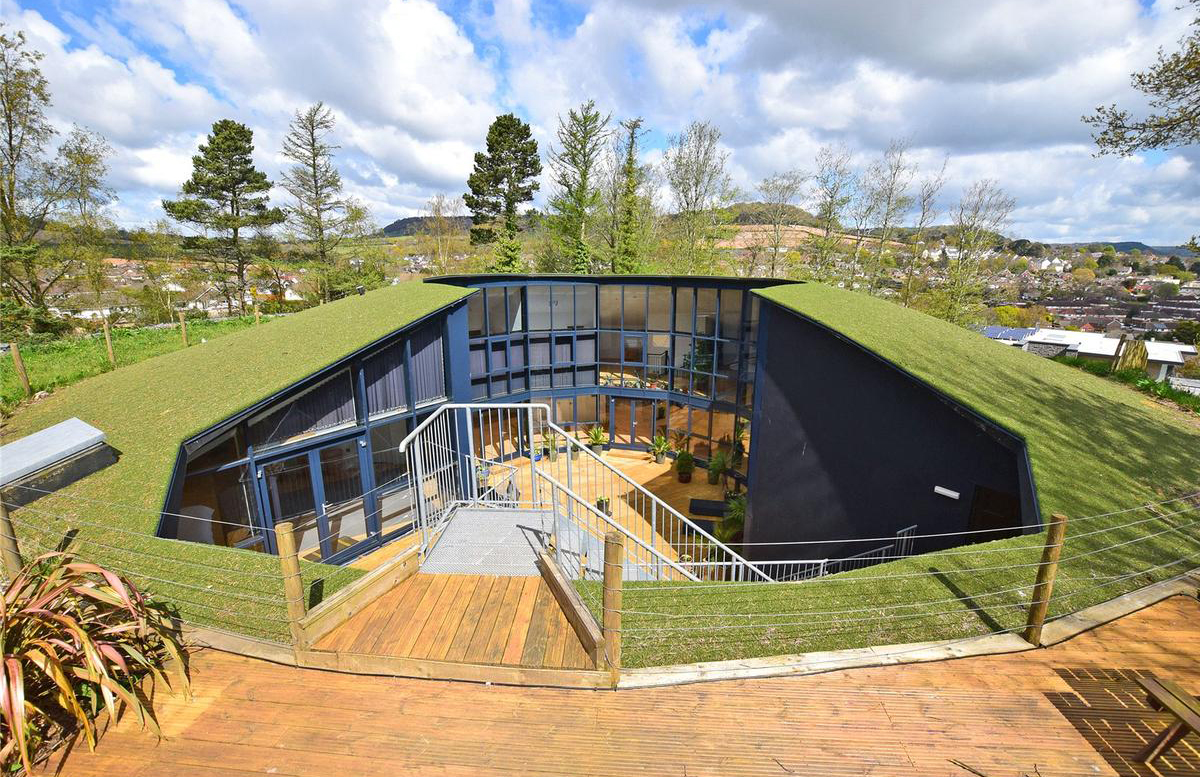 Converted water reservoir in devon goes on sale for for What goes into building a house