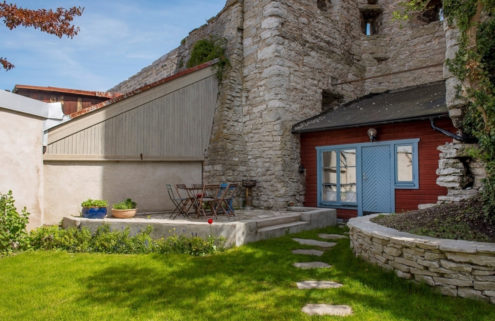 A holiday home embedded in medieval walls is on the market in Sweden