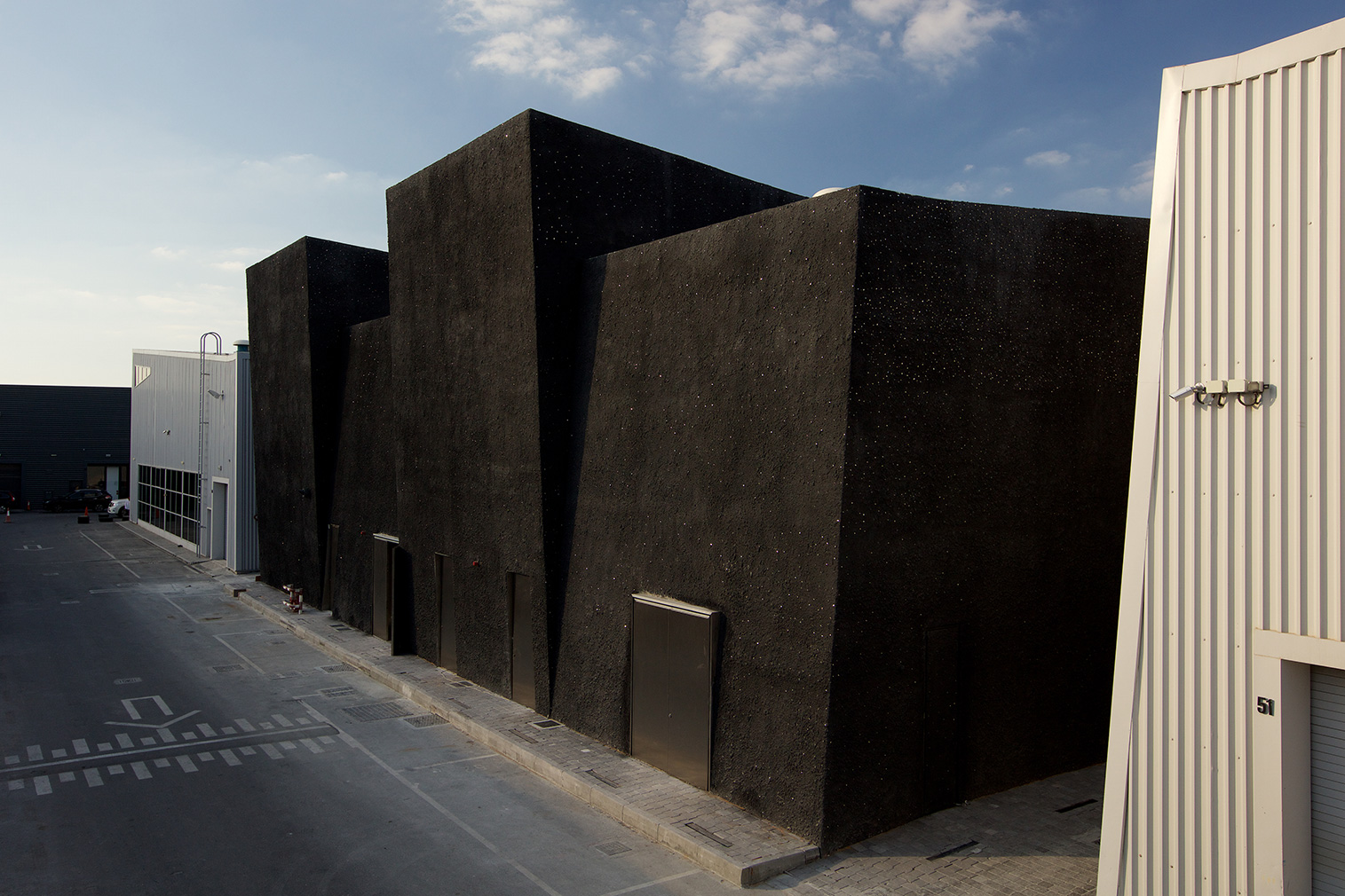 Concrete cultural space by OMA on Dubai's Alserkal Avenue