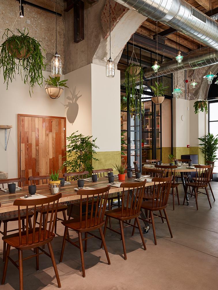 Plant filled restaurant soulgreen springs up in milan
