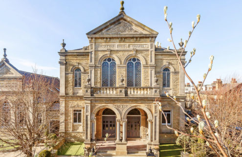 Converted chapel for sale in Harrogate has high ceilings and a living room pulpit