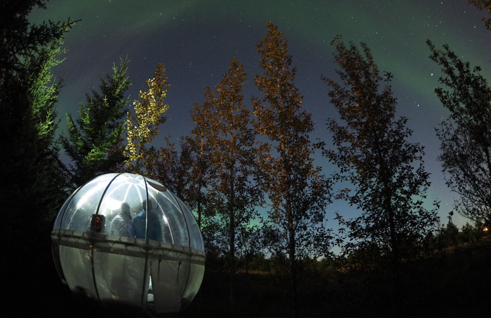 5 Million Star Hotel / Buubble in Iceland - it's exact location is kept a secret, but it's surrounded by forest and has clear views of the Northern Lights