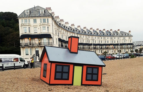 Artist Richard Woods dots a British seaside town with cartoon tiny homes