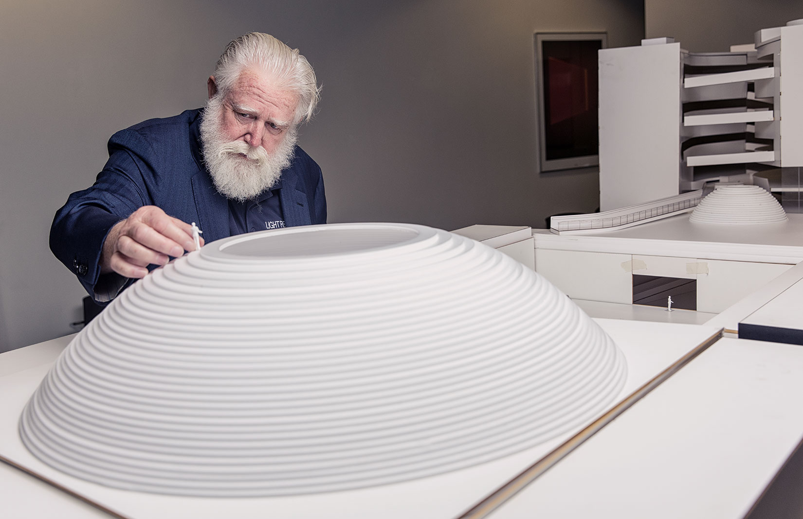James Turrell with a model of The Dome – a semi subterranean gallery for performance art