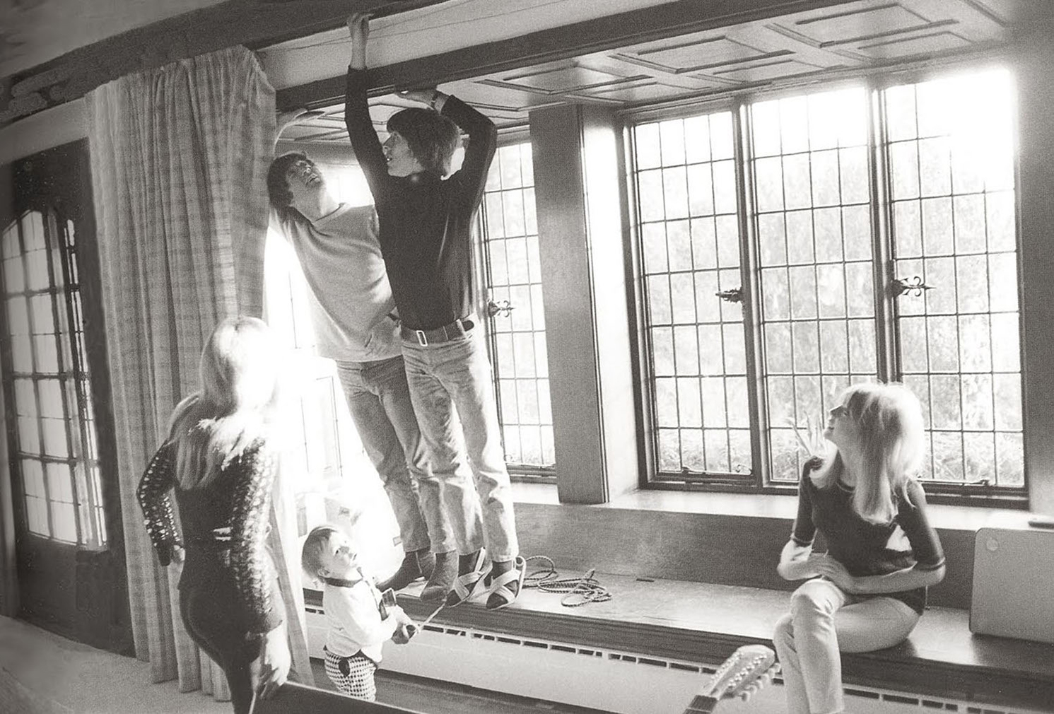 John Lennon and Ringo Starr hanging curtains inside Kenwood, circa 1964. Via Knight Frank