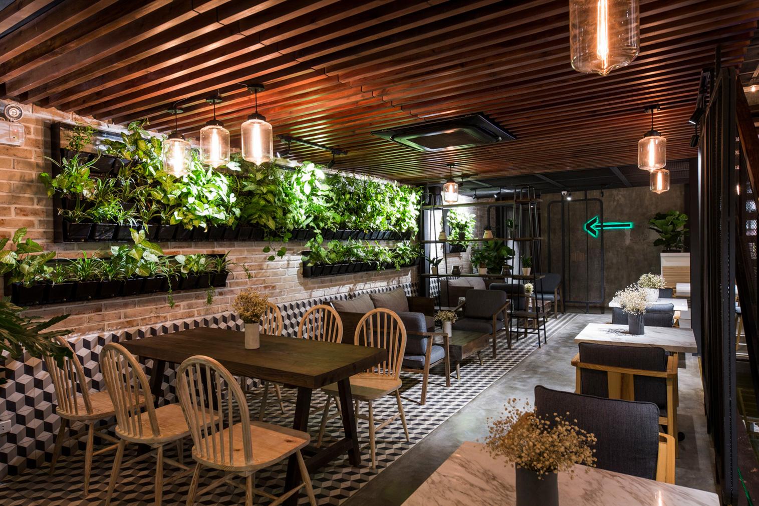 le house designs a secret garden caf in hanoi rh thespaces com open garden restaurant design