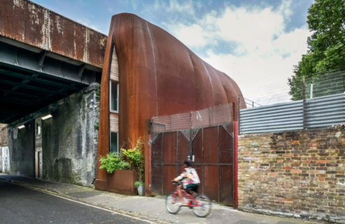 A billowing steel home built beneath a London viaduct lists for £1.1m