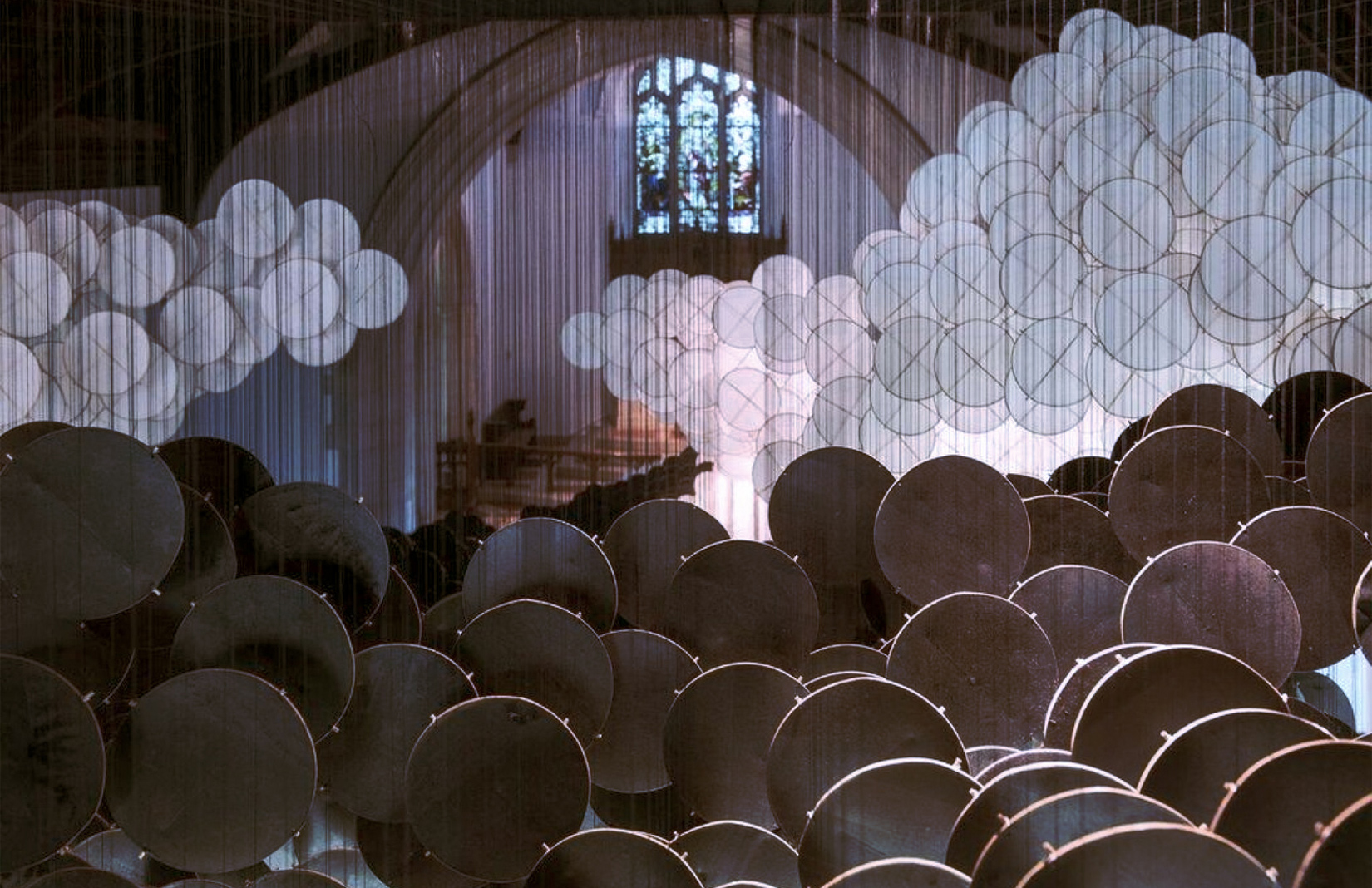 Jacob Hashimoto creates a paper cloud in a chapel on Governors Island