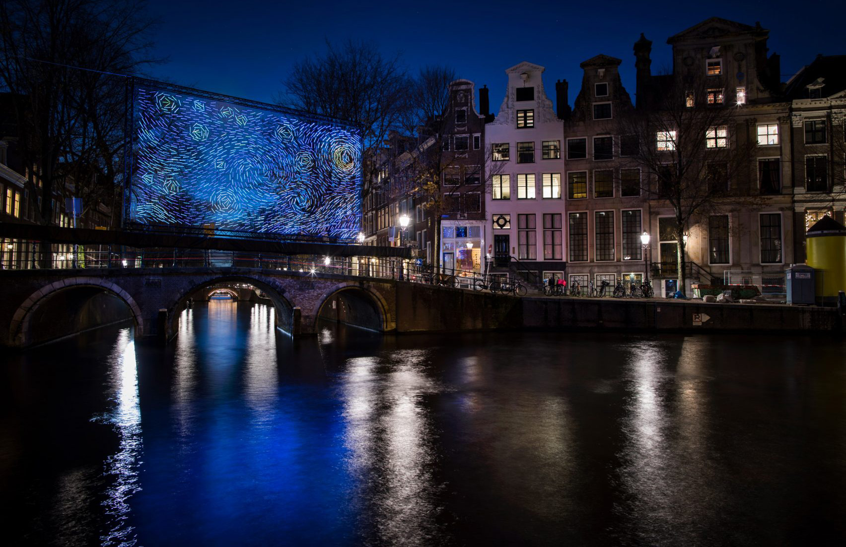 Van Gogh's Starry Night illuminates an Amsterdam bridge