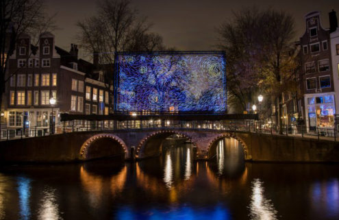 Van Gogh's 'Starry Night' illuminates an Amsterdam bridge