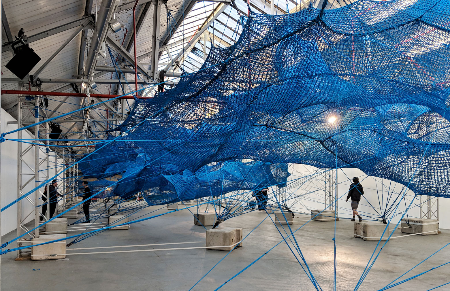Arts collective Numen/For Use weaves a giant net inside London's Brewer Street Car Park
