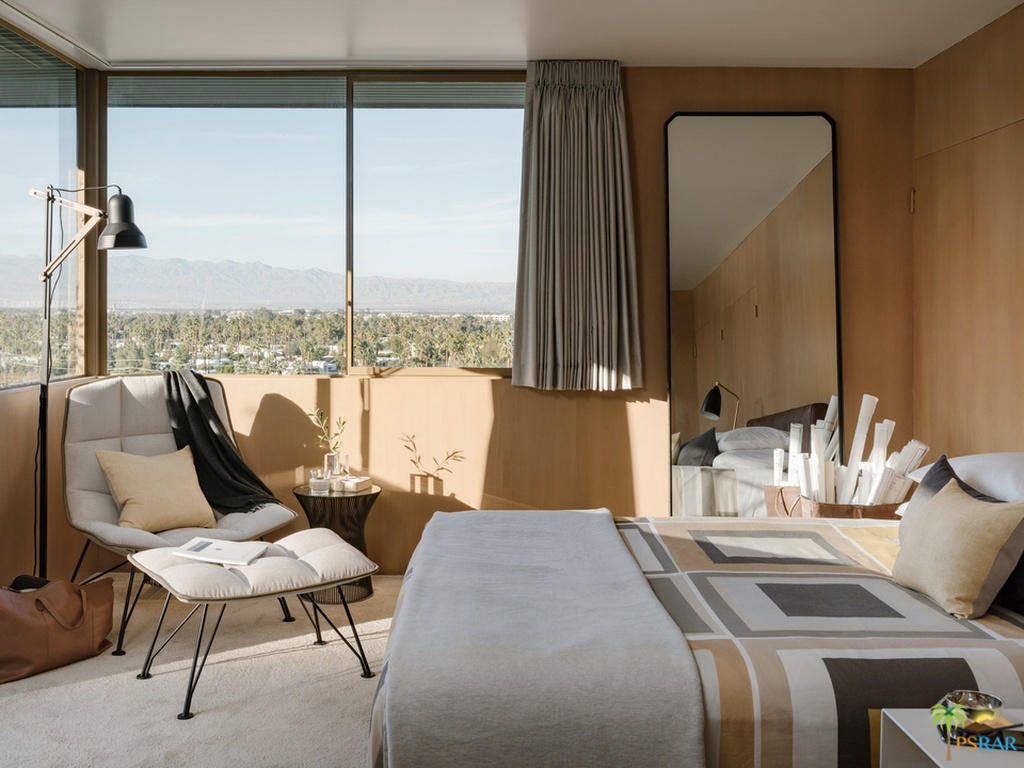 67389 E Palm Canyon Drive's master bedroom suite: oversized picture windows frame desert views