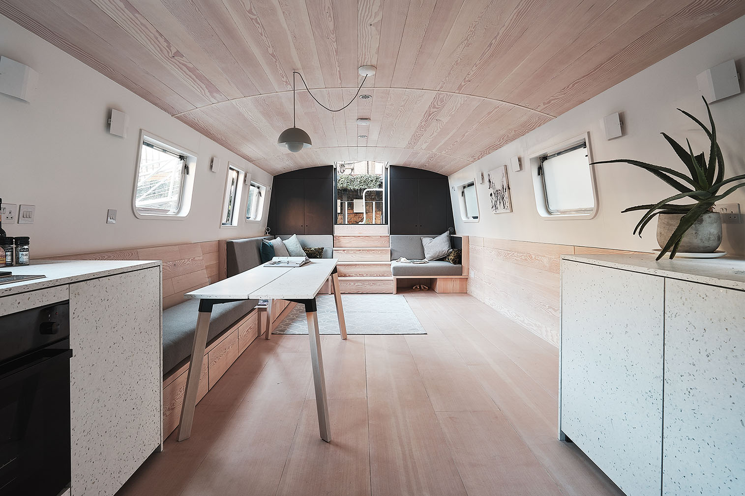 Interiors of The Dusky Parakeet house boat designed by 31/44 Architects. It's for sale via Aucoot