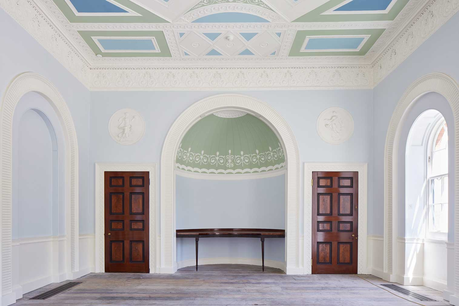 A reception room inside London's Pitzhanger Manor, which features bold colours and neo-classical symmetry