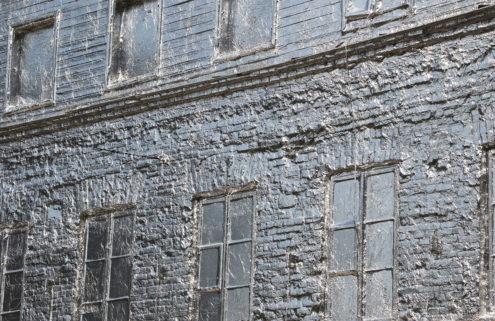 Polish artist Piotr Janowski wraps a Warsaw building in tin foil