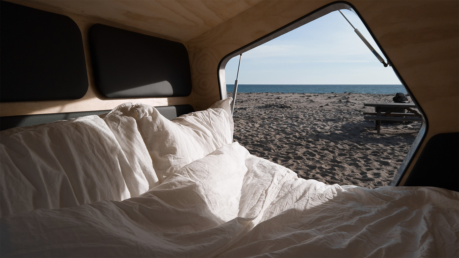 Inside the Polydrop camper - it features minimalist pine walls and leather detailing