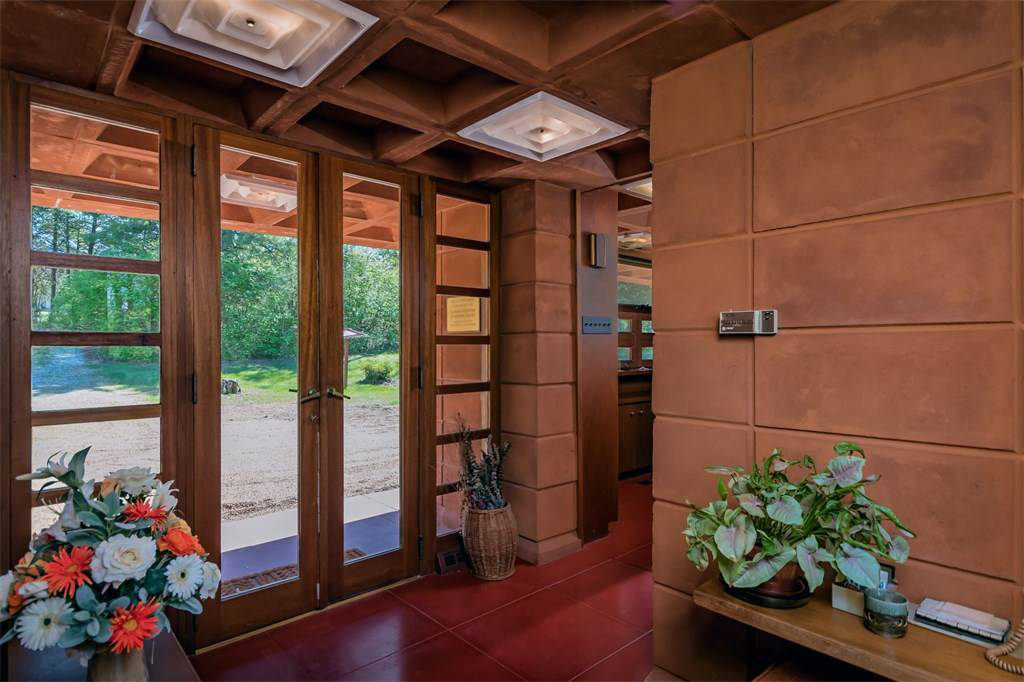 The Theodore and Bette Pappas House: the hallway features original red floor tiles and exposed concrete walls