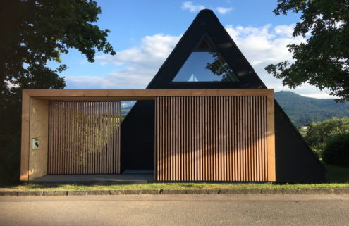 A 1970s A-frame is given a minimalist makeover near Salzburg
