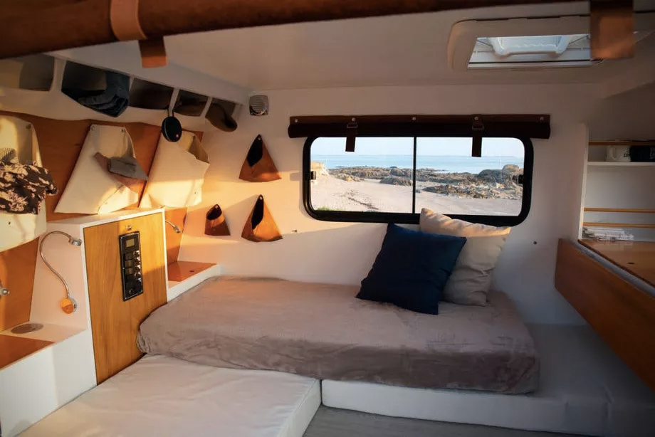 This lightweight trapezoid camper by Carapate Adventure in inspired by a boat