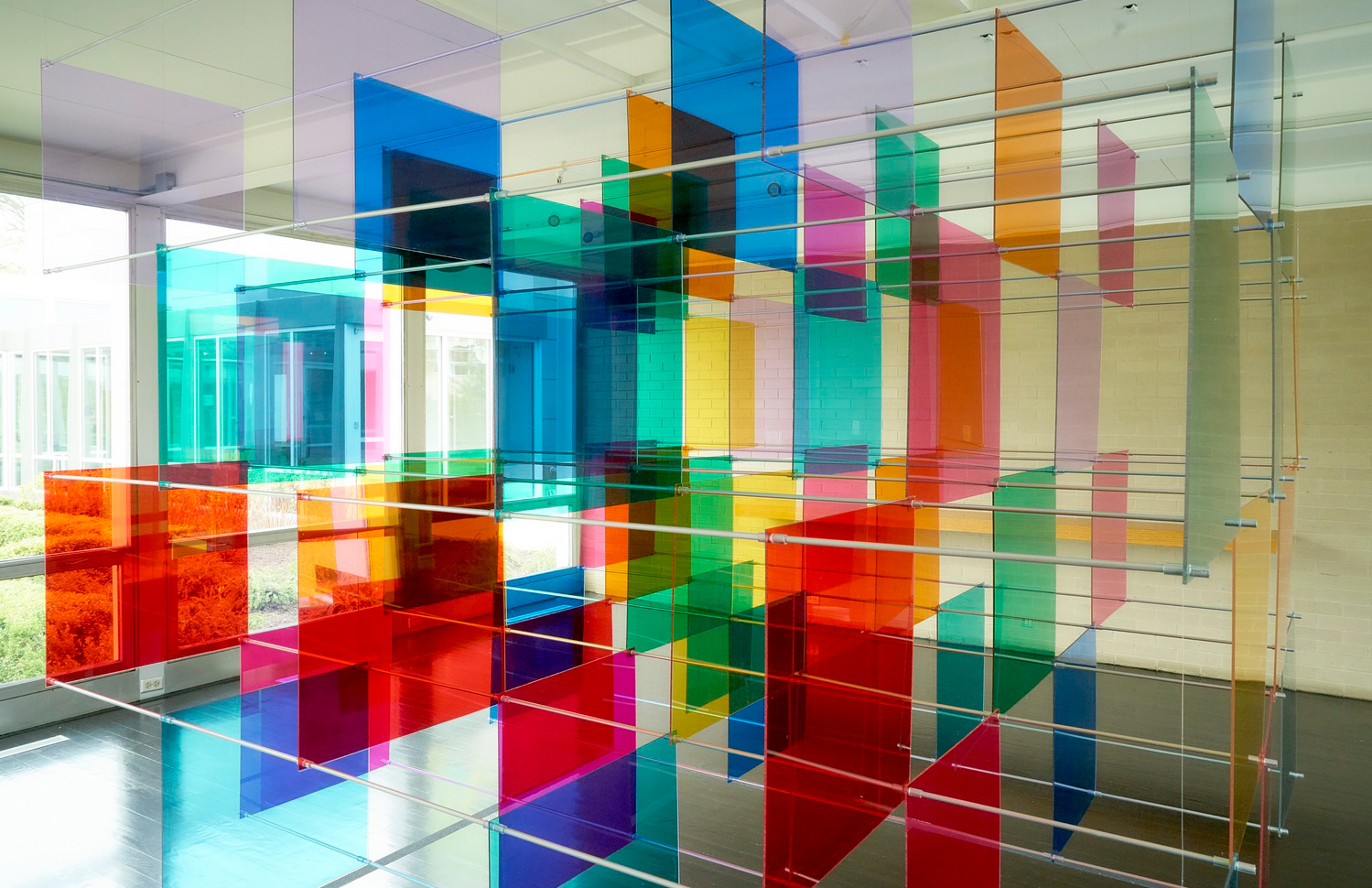 Art duo Luftwerk has installed a floating grid of colour inside Mies van der Rohe's McCormick House in Chicago.