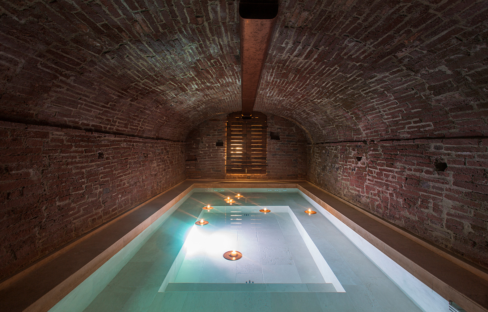 A plunge pool is hidden in a vaulted cellar beneath the loft