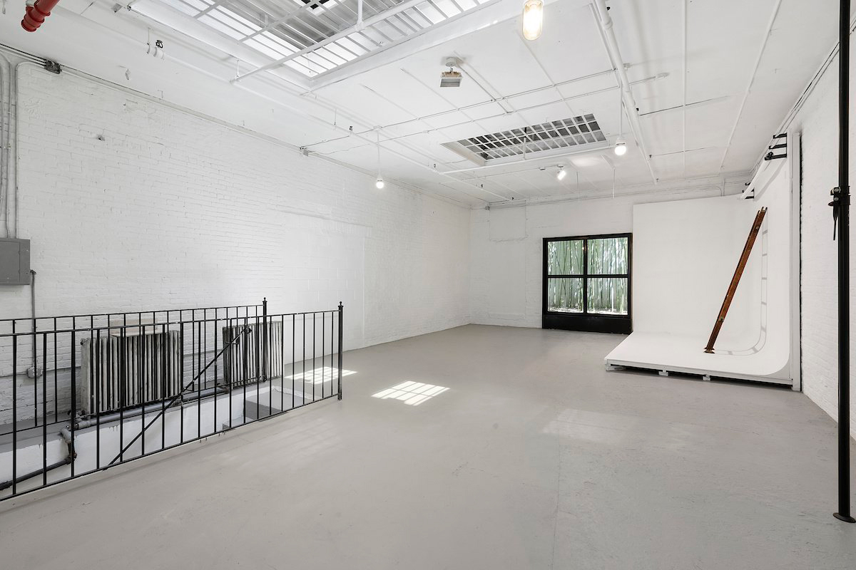 A 1,350 sq ft basement space, which could potentially be used as a gym, studio, or office.