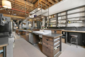 converted firehouse for sale in brooklyn's williamsburg: rustic meets industrial in the kitchen