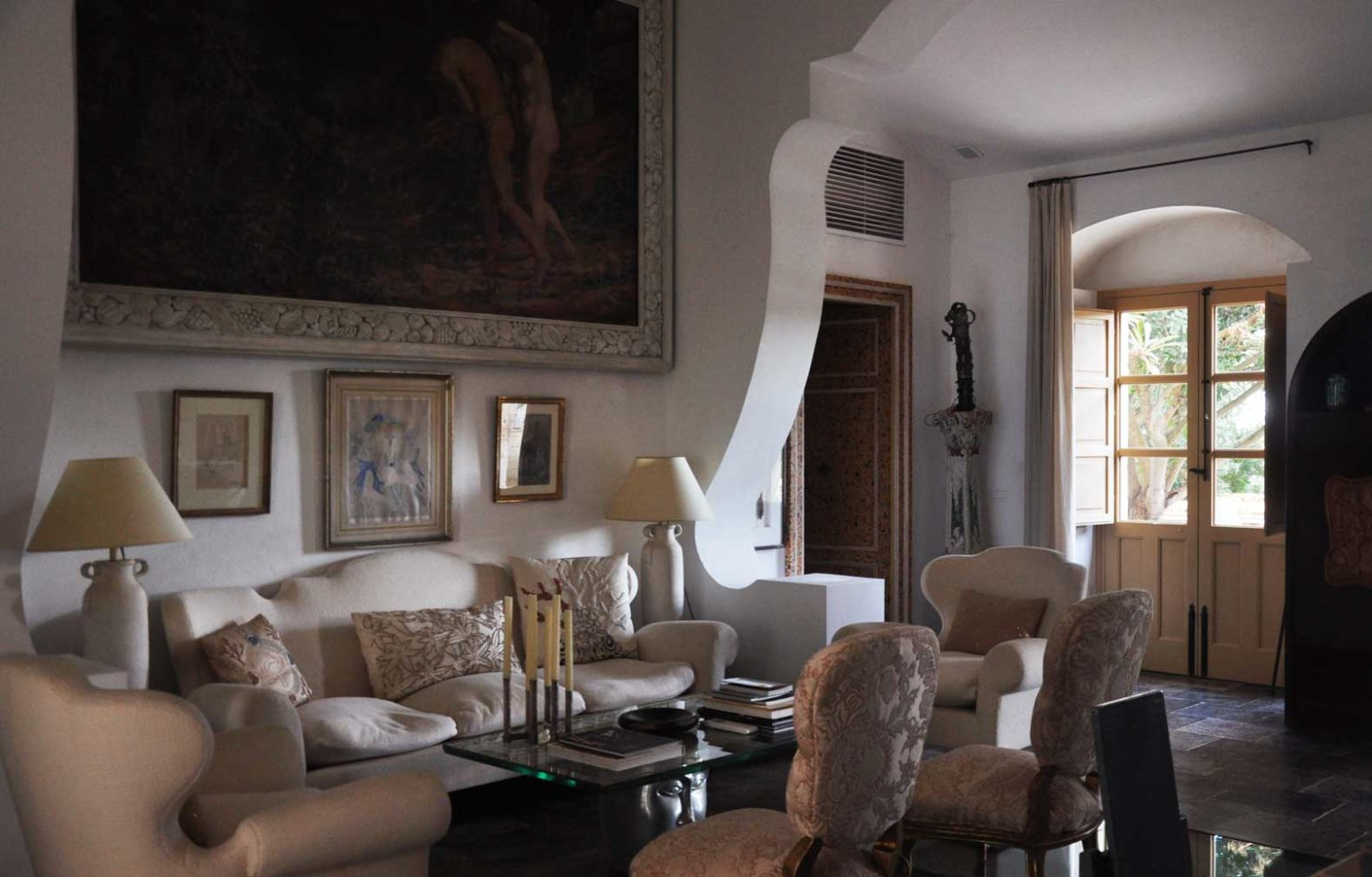 Maison des Oliviers living room is fulled with antiques