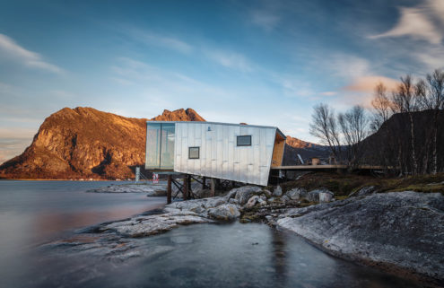 Aluminium-skinned cabins perch over the Barents Sea in the Arctic Circle