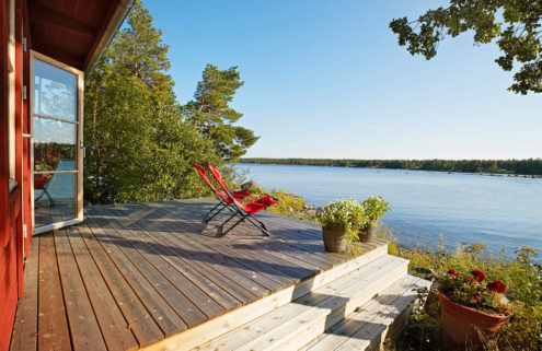 A private Swedish island with striking red cabin home could be yours