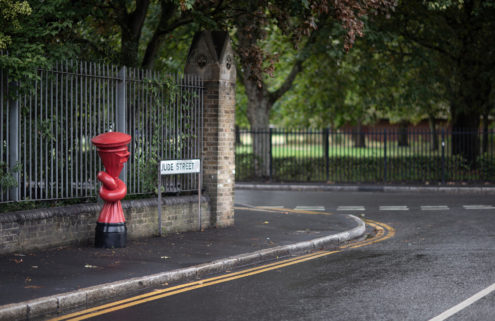 Alex Chinneck gives the UK's iconic red post box a twist