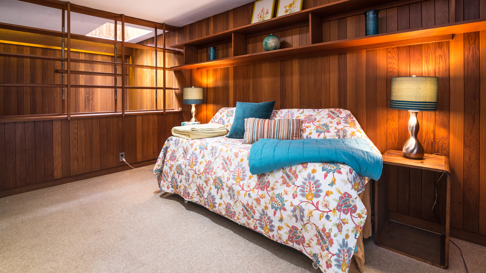 Bedrooms at The Tivadar and Dorothy Balogh House have original custom built midcentury cabinetry - this second room doubles as a study and reading space