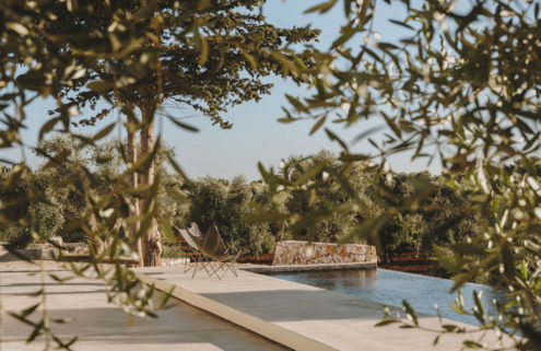This stone villa nestles into the olive groves of the Puglian countryside