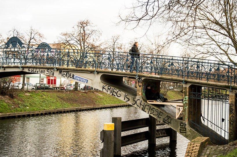 This parasitic micro 'refuge' is tucked beneath a Berlin bridge
