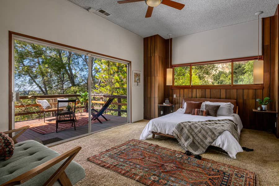 The master bedroom opens onto a large private terrace overlooking the canyon