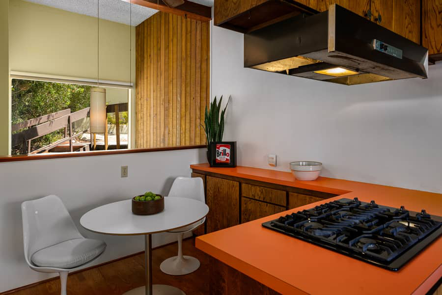 Formica worktops, tongue-and-groove ceilings, wood-panelled walls and salvaged cabinetry fashioned from stereos are just some of the original midcentury modern features inside the 2,5000 sq ft home