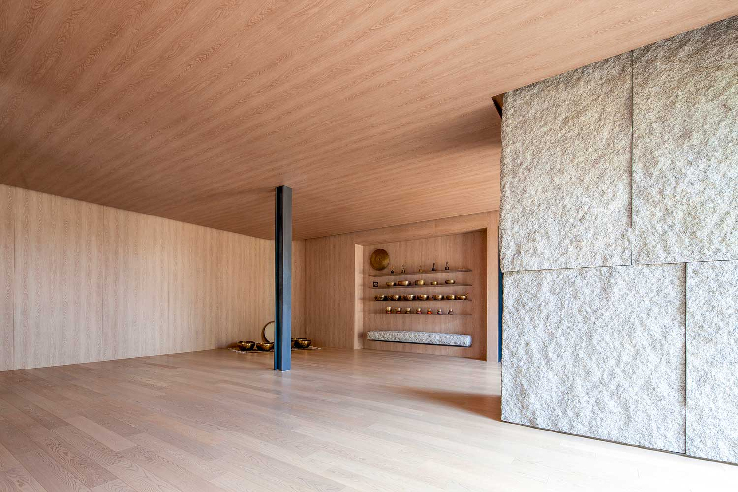 The Yoga studio uses a range of textures to enliven the five senses: wooden ceilings, concrete pullars and steel supports also reflect the connection between the manmade and the natural
