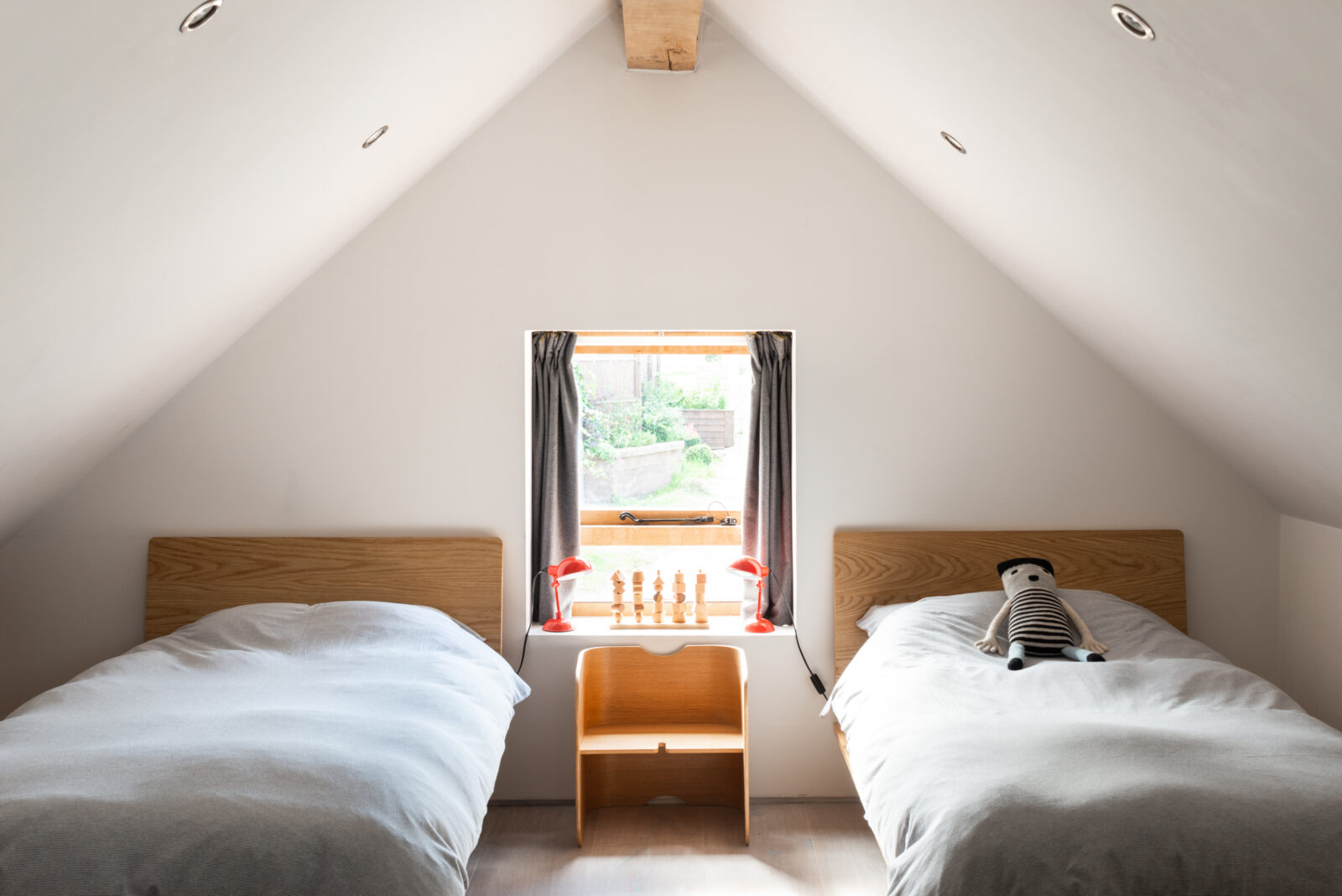 Gabled ceilings and thick oak beams add character in the bedrooms.