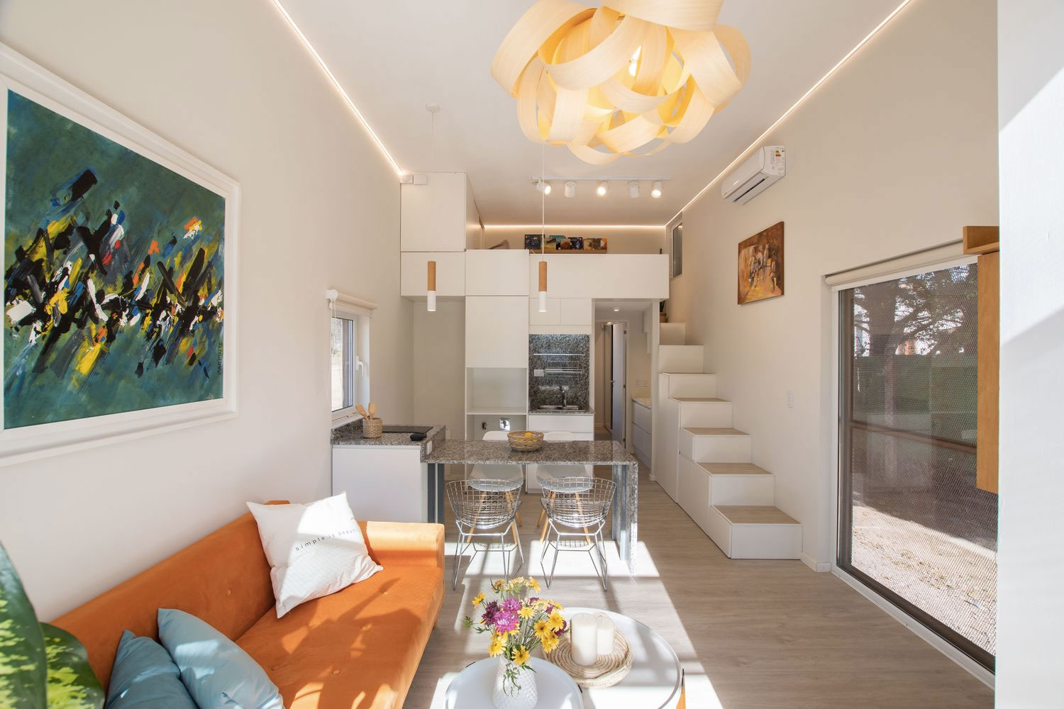 Hüga's open plan layout houses a kitchen, separate bathroom, mezzanine bedroom and an open living room