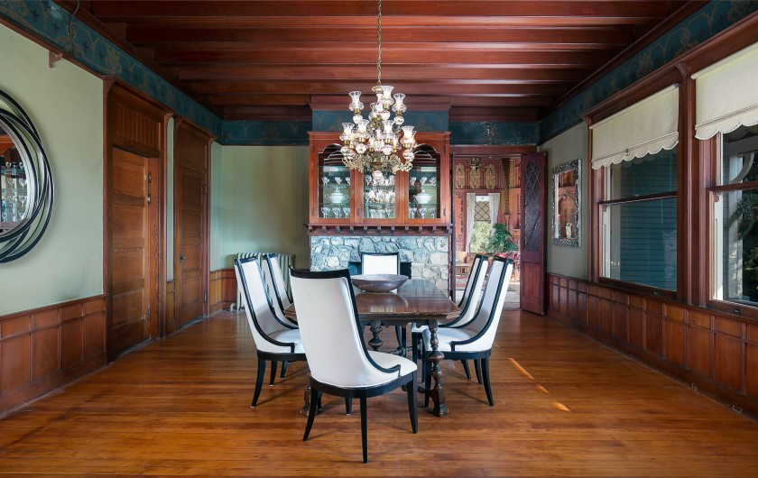 Period details such as hardwood ceilings, wall panelling and tiled fireplaces are all intact